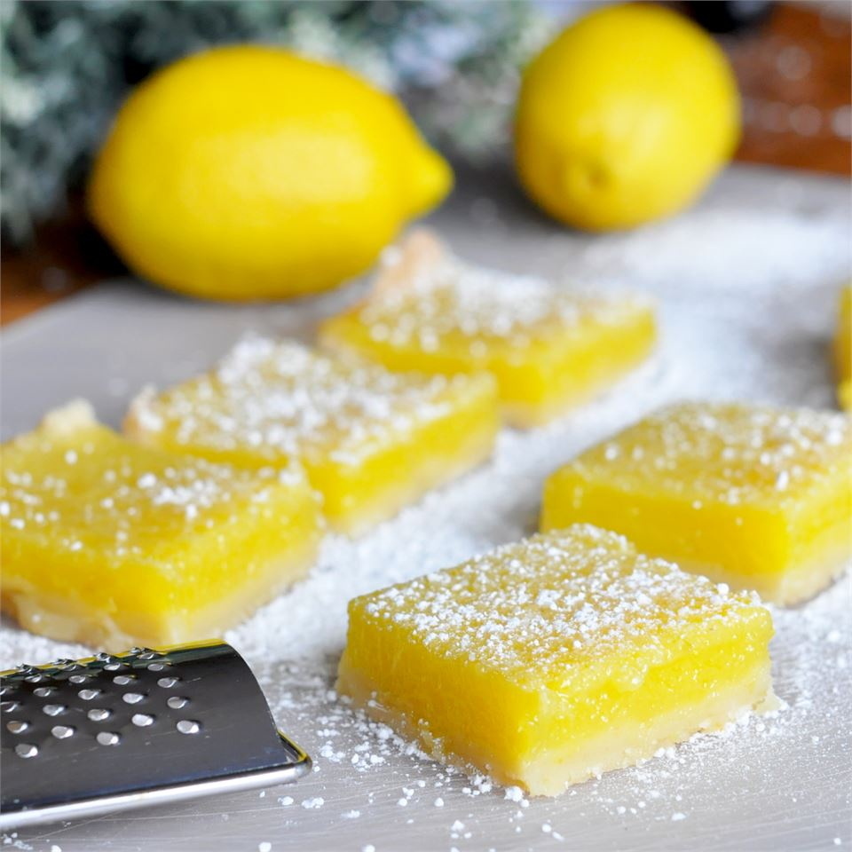 lemon pie bar squares dusted with powdered sugar