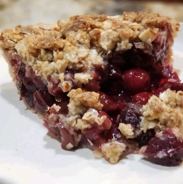 Chef John's fresh cherry pie is topped with a crunchy and nutty streusel made with slivered almonds, brown sugar, oats, butter, and flour.