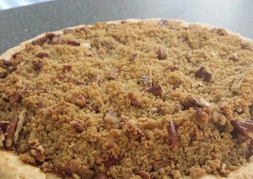 Make this lightly spiced autumnal pie with staple fall flavors like apple and pumpkin. A buttery, dark brown sugar-pecan streusel topping is the perfect finishing touch.