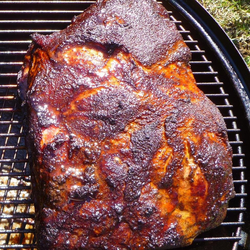 overhead view of smoked pork shoulder on a grill