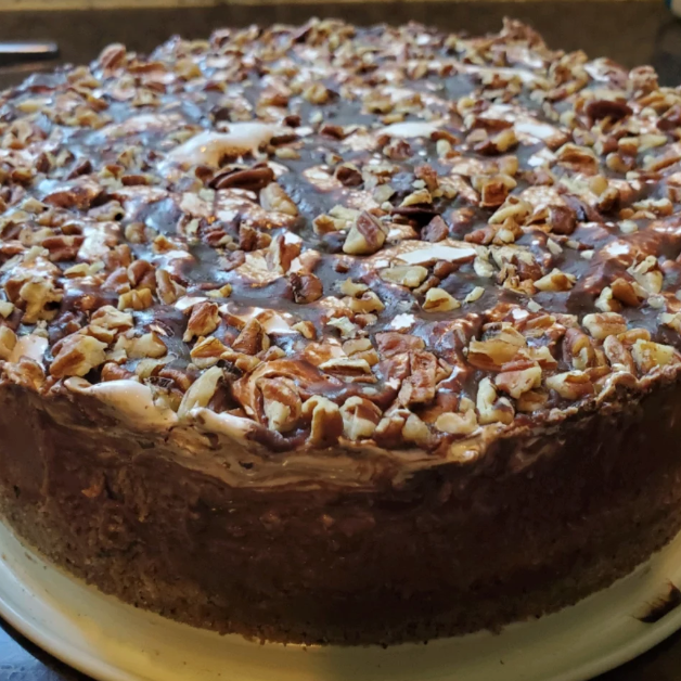 All the essential flavors of the Mississippi mud cake (chocolate, pecans, and marshmallows) come together in this delicious cheesecake. Drizzle with a 4-ingredient chocolate topping.