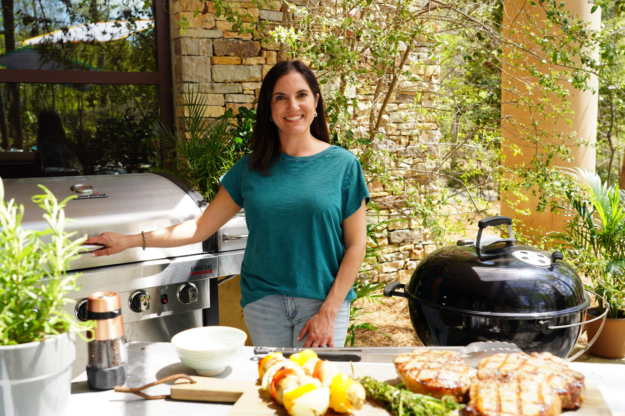 nicole mcmom with gas grill and charcoal grill, plus grilled food and accessories