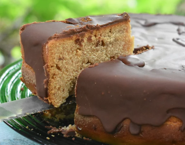 A 6-ingredient, brandy-spiked chocolate glaze is spread over a cozy honey cake spiced with cinnamon and cloves.