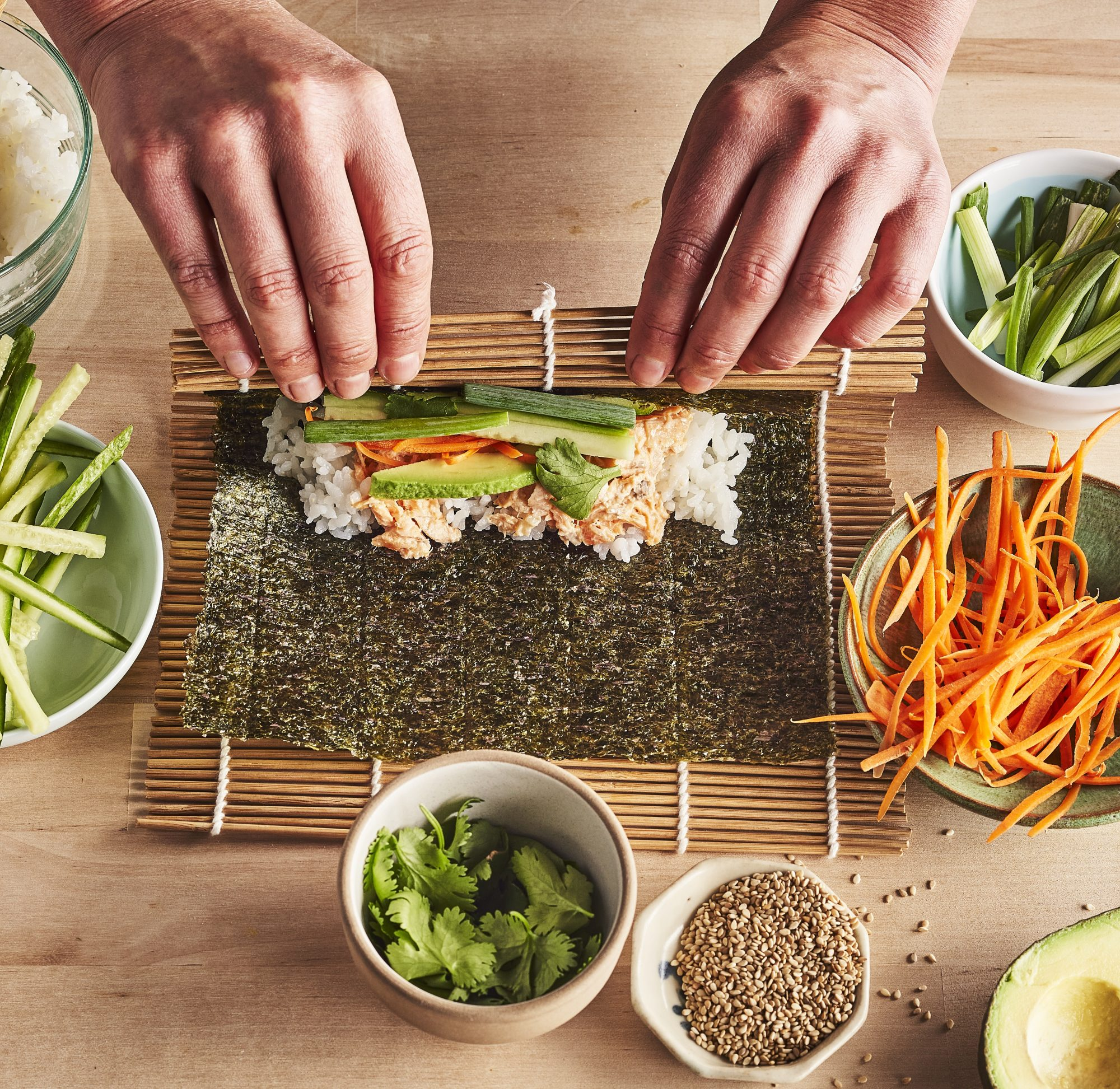 Sushing rolling mat with ingredients for sush