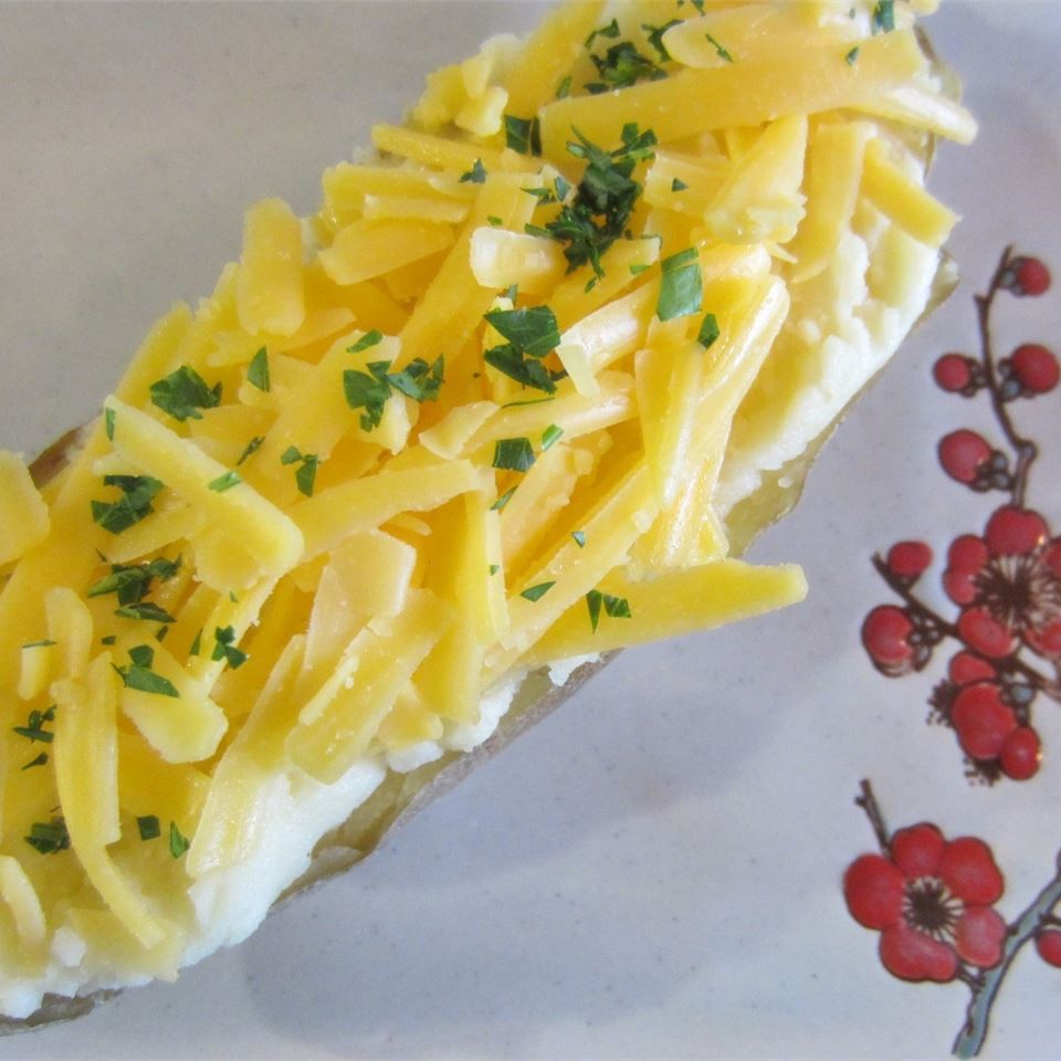 potato with shredded cheese and herbs