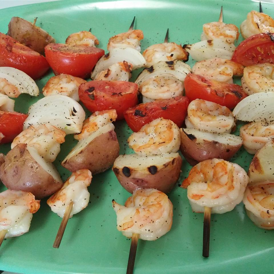 shrimp, potatoes, tomatoes, and onion on skewers