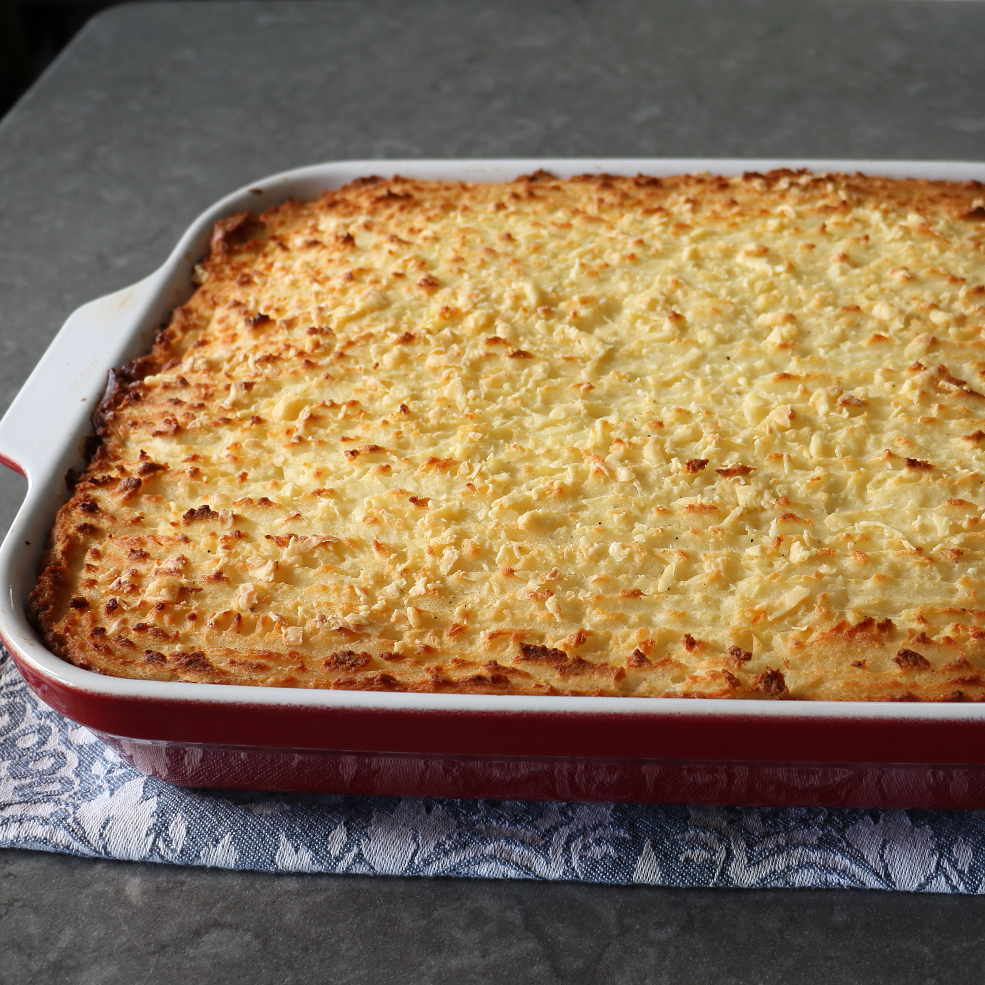 Corned Beef and Cabbage Shepherd's Pie in a red dish