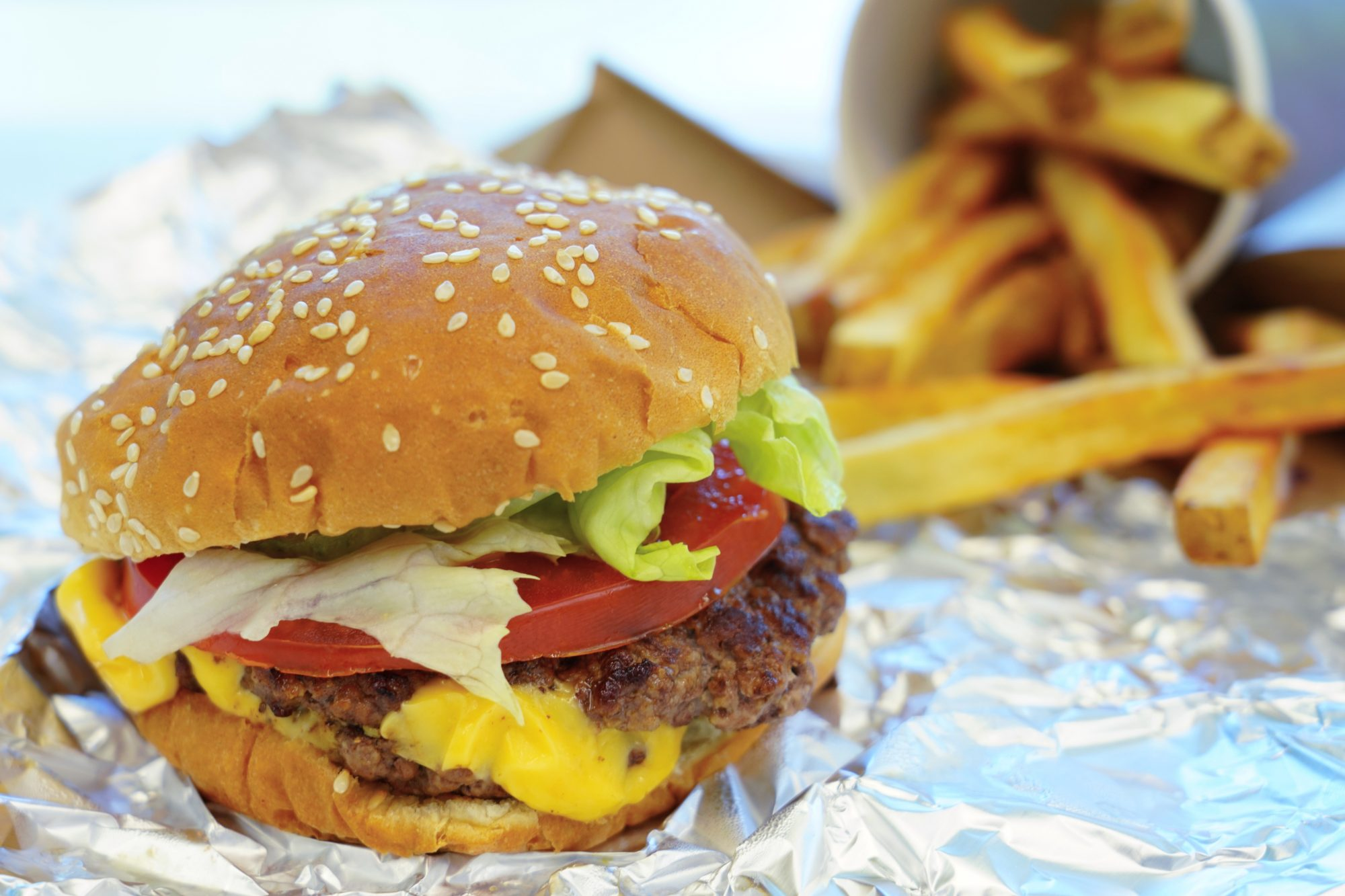 copycat burger and fries on foil wrapper