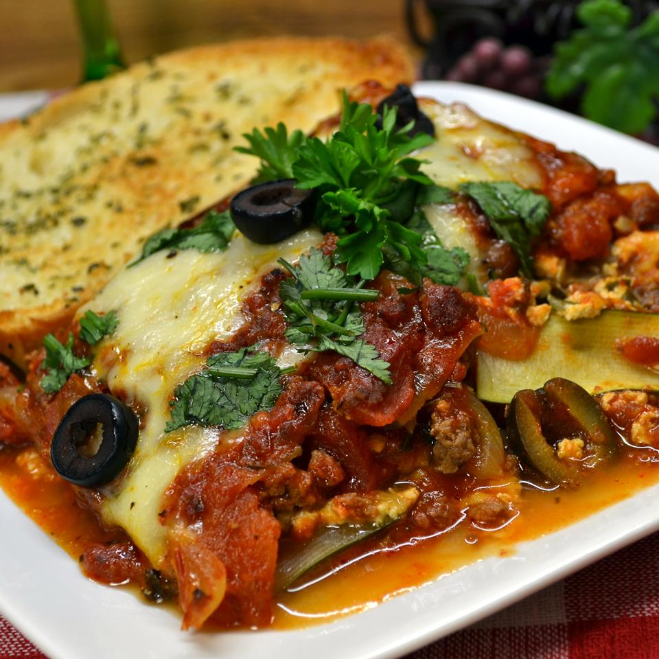 Zucchini Lasagna With Beef and Sausage on a white plate