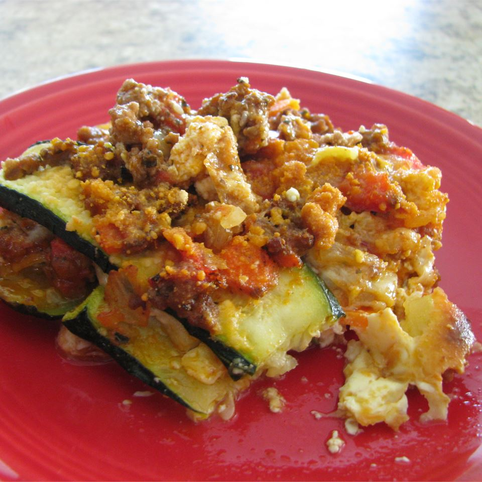 Summer Lasagna on a red plate