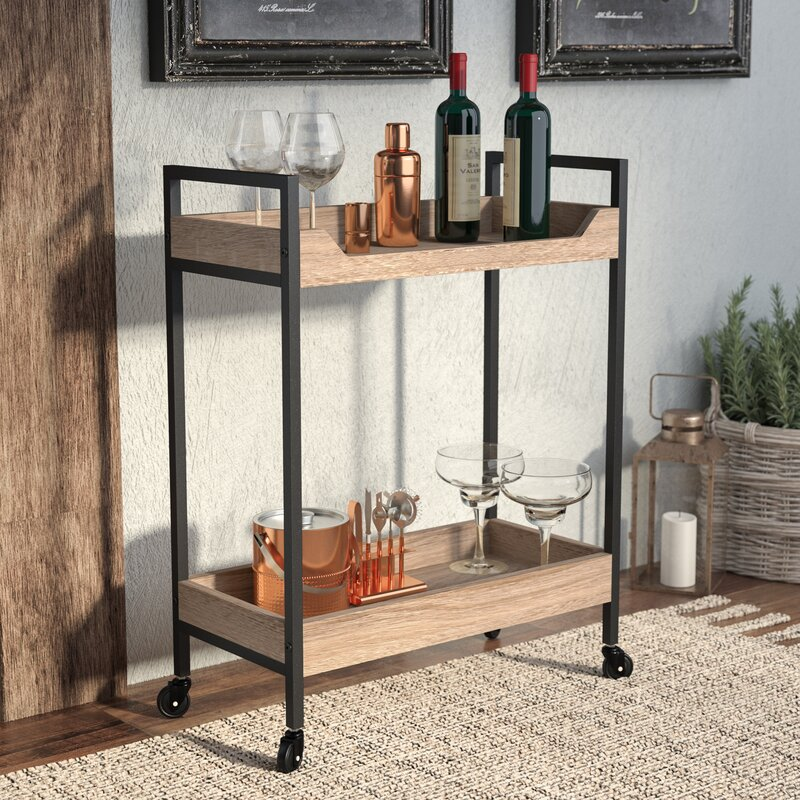 rolling bar cart with liquor, glasses, and bar tools