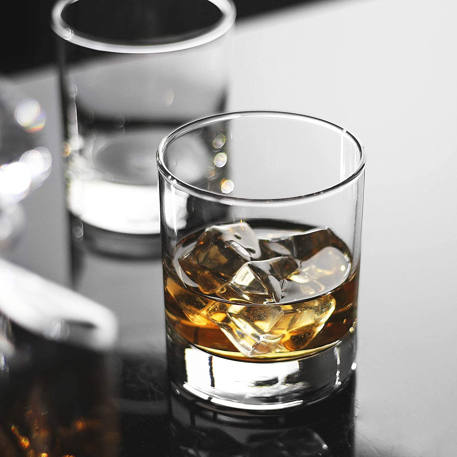 rocks glass with whiskey and ice inside