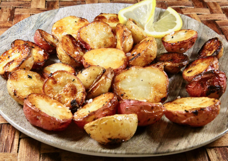 These roasted fingerling potatoes are simply flavored with olive oil, garlic powder, kosher salt, and the juice of one lemon.