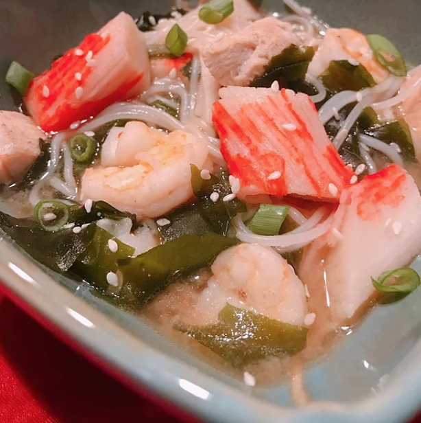 Everyone at your table will love this savory miso broth filled with shrimp, chicken, and rice vermicelli noodles. Top with sesame seeds and green onions.