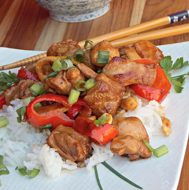 Here's a quick and easy chicken dish that everyone at your dinner table is sure to love. The sweet brown sugar offsets the bite that comes from the rice vinegar, fish sauce, and hot sauce.