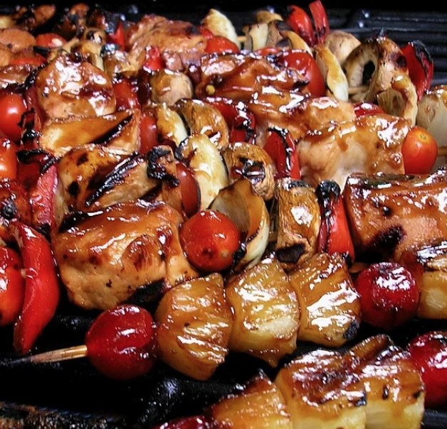 These grilled chicken, tomato, bell pepper, and pineapple kabobs are perfect for your next summertime cookout. The honey-cayenne pepper-lime sauce also works well on chicken wings, says recipe creator Snacks.