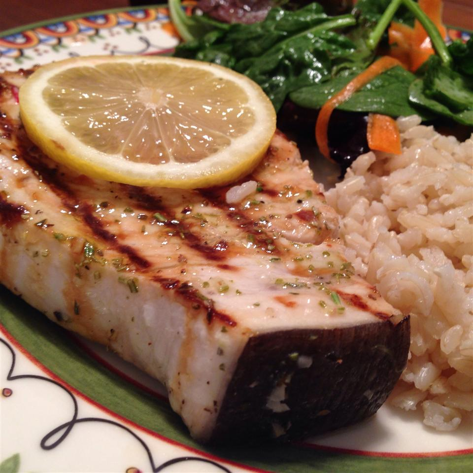 grilled swordfish steak with rice and greens