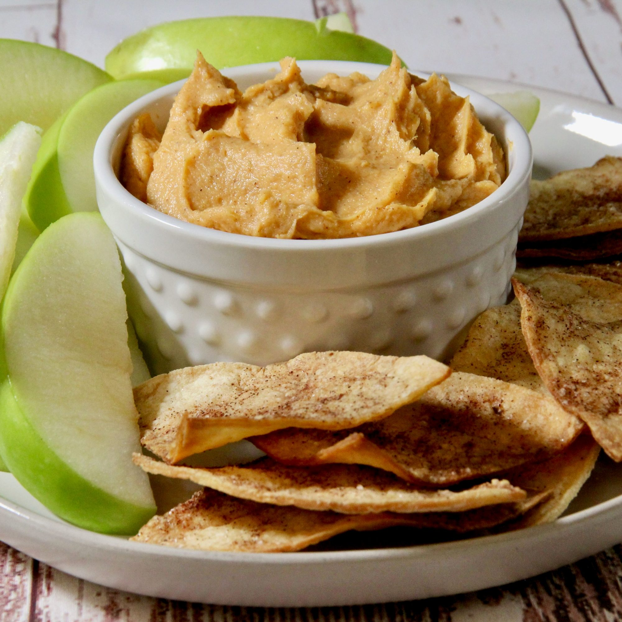 """Mashed sweet potato is whipped up with yogurt, orange juice, peanut butter, and cinnamon to make this clever sweet potato dip to serve with toasted bagels, raisin bread or apple wedges. """"I made it for breakfast for my grandchildren and we all loved it!"""" says reviewer Deborah Wooten."""