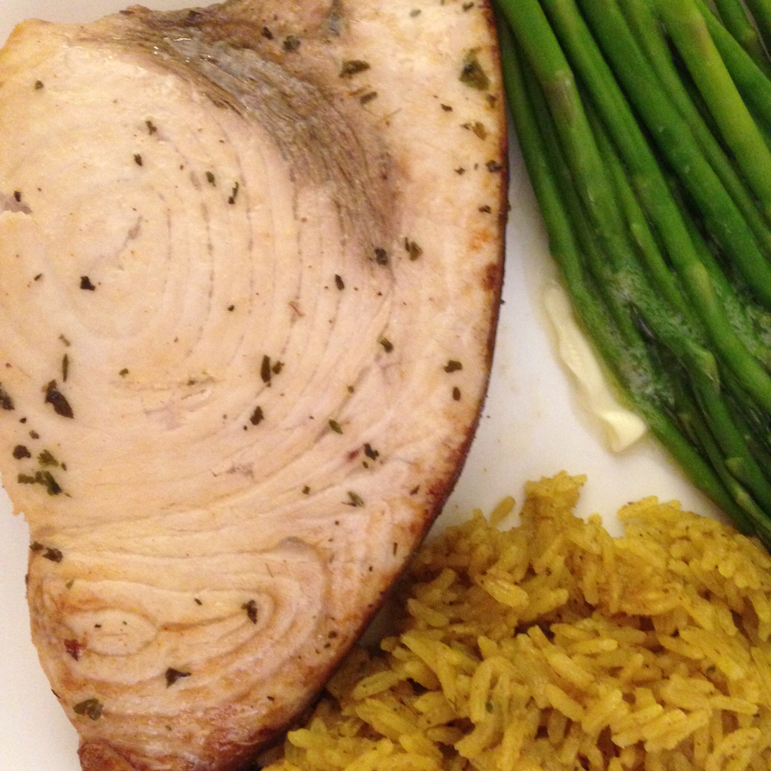 grilled swordfish steak with rice and asparagus