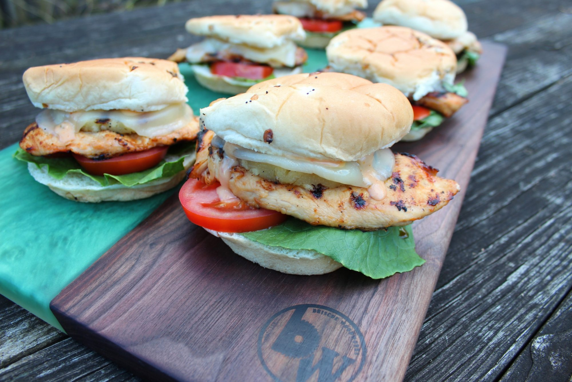 grilled chicken sliders with cheese, pineapple, tomato, and lettuce