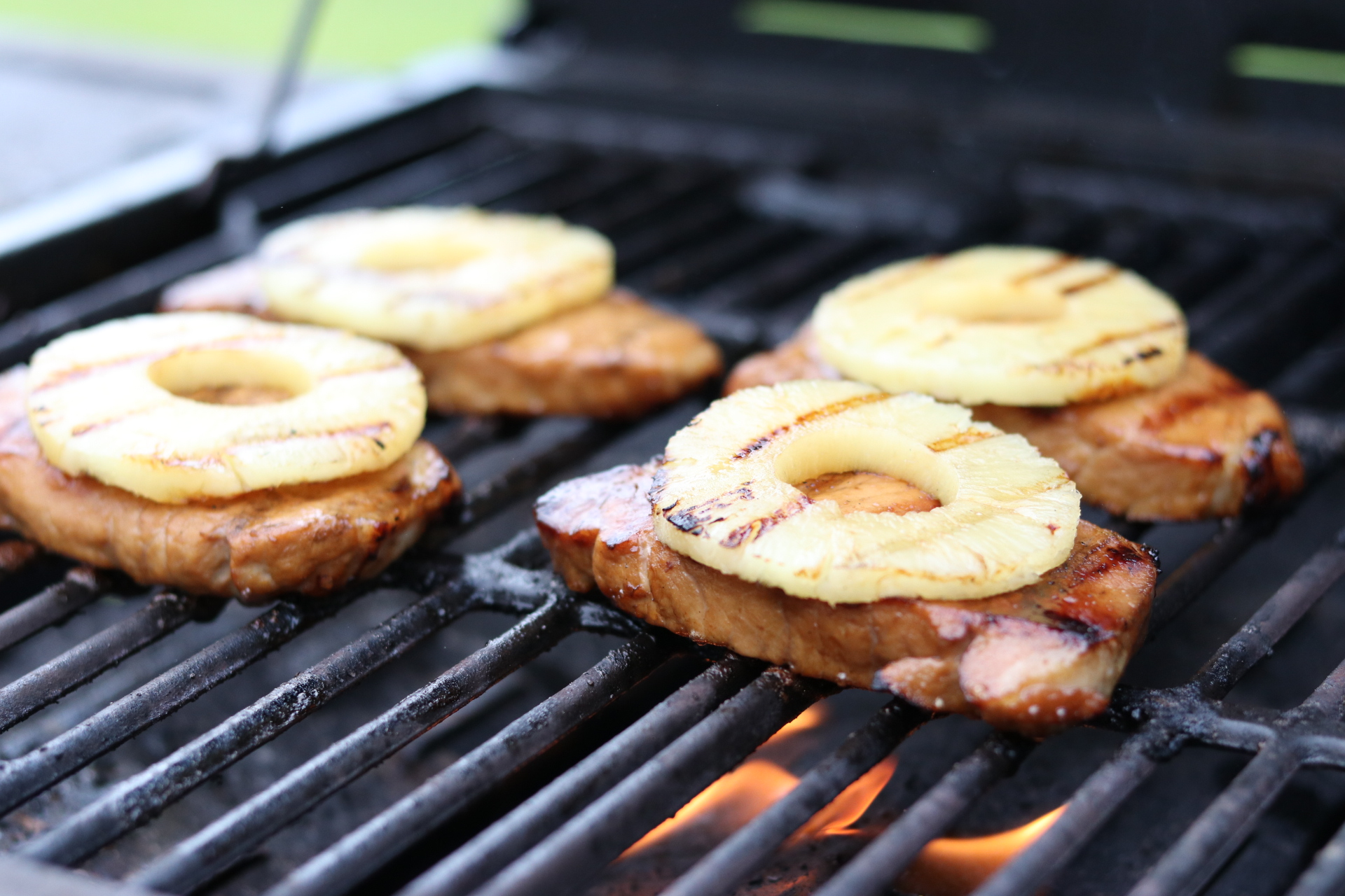 pork chops with pineapple rings on the grill