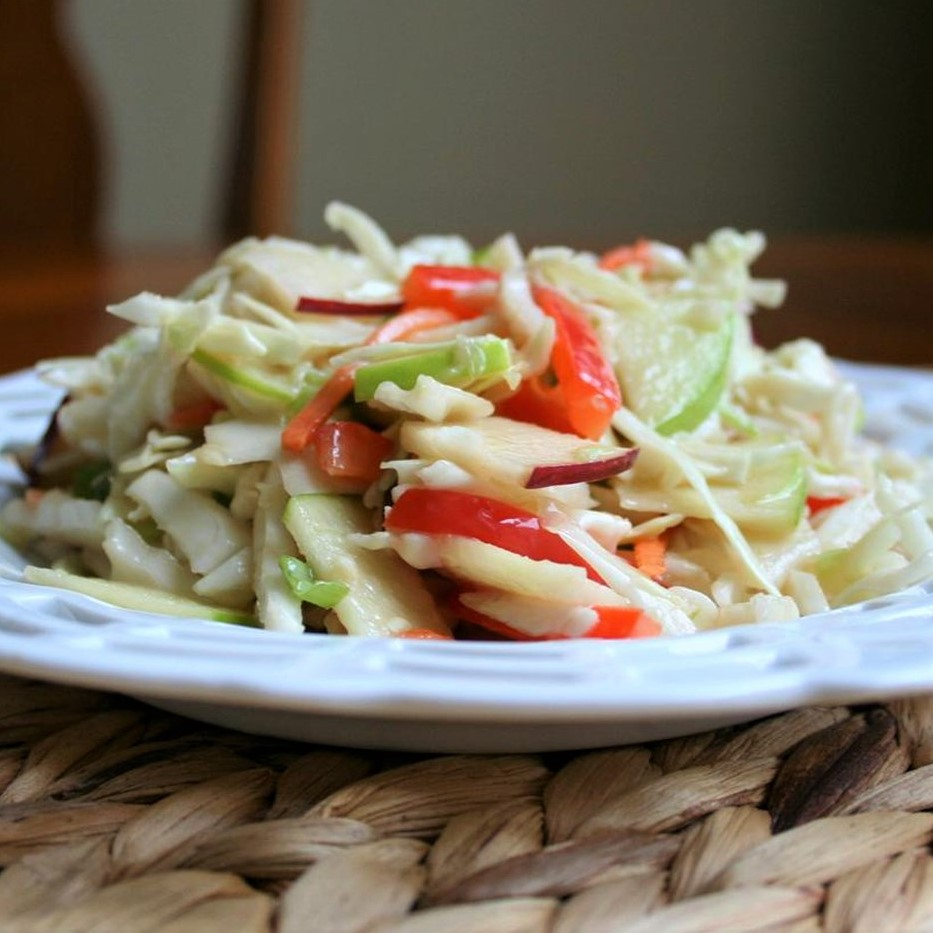 a plate of apple coleslaw