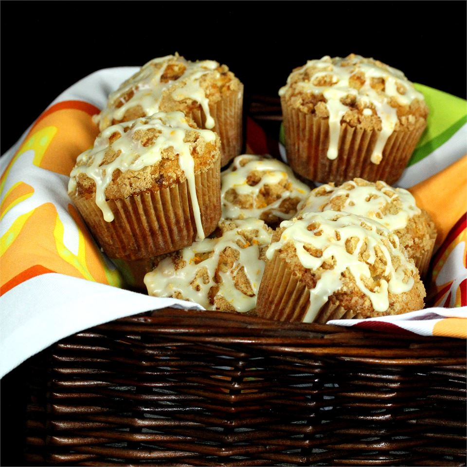 muffins with icing in basket