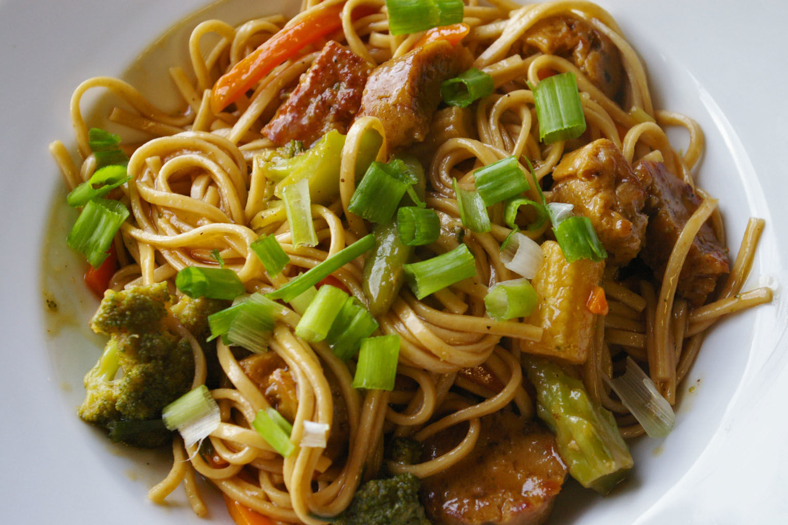 Tender pieces of chicken, shiitake mushrooms, green onions, and noodles are tossed in a homemade ginger, garlic, and soy lo mein sauce. Leftovers taste great served cold as a noodle salad the next day. Linguine pasta works well but try using Chinese noodles for a more authentic dish.