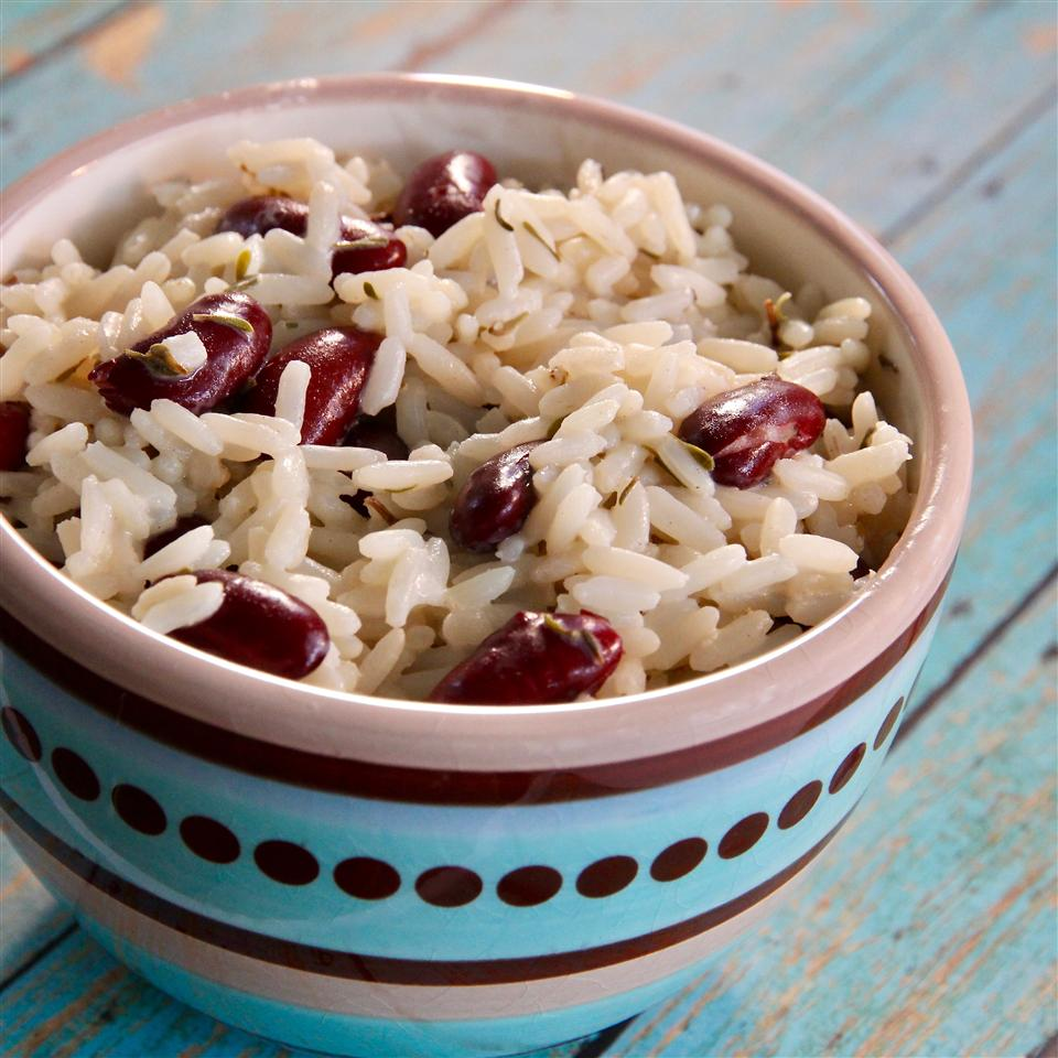 Rice is cooked in coconut milk with kidney beans, thyme, and cloves in this fragrant, creamy side dish that goes well with Caribbean-style jerk chicken or meaty curries. Add a pinch of spicy creole seasoning or garnish with thinly sliced chili peppers if you prefer things hot!
