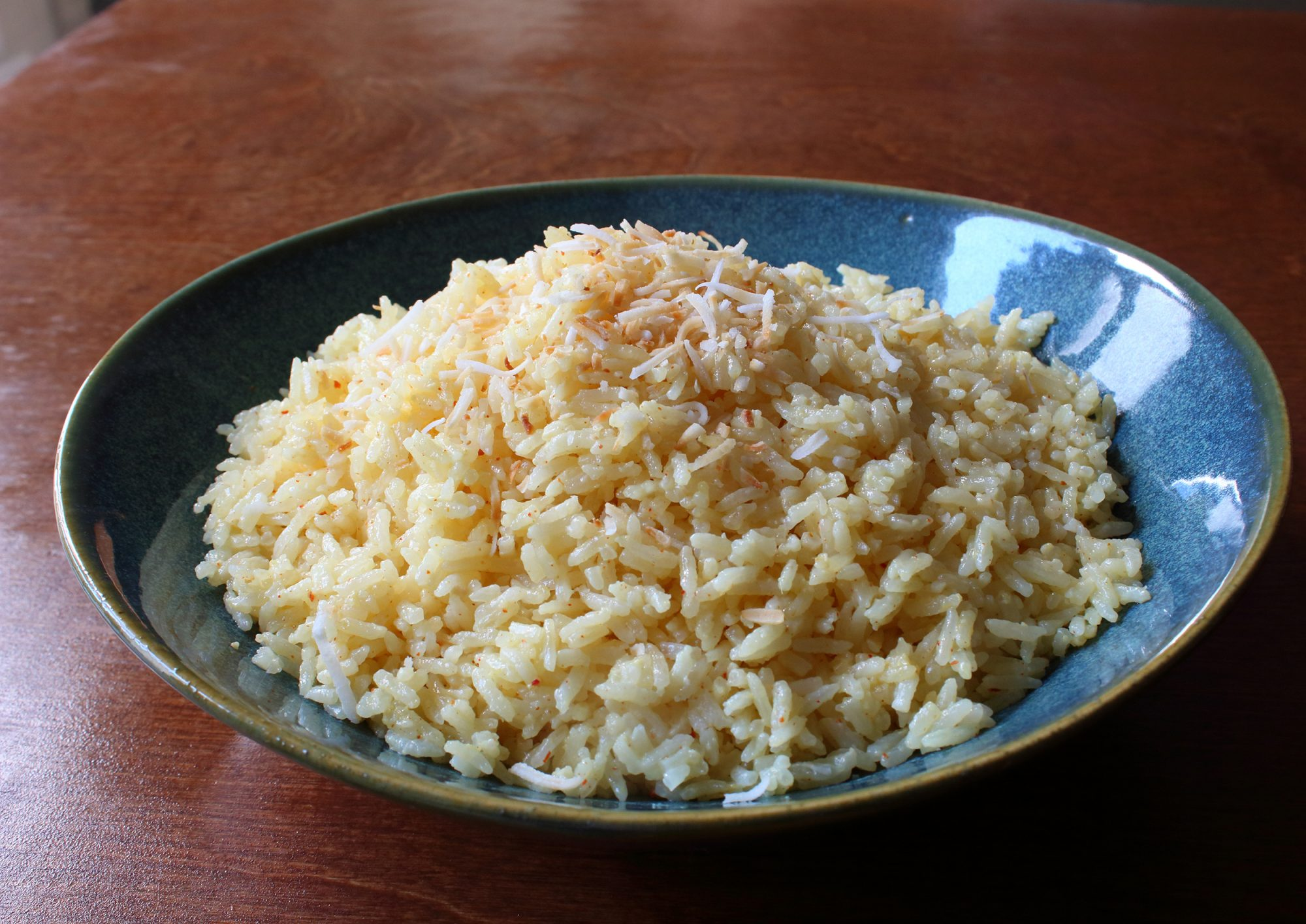 """""""I love coconut rice, especially as a side for spicy grilled meats but when I order it out, it's usually too sweet for my tastes,"""" says recipe creator Chef John. """"I decided to create a more savory version at home. There are lots of things you can add, like herbs, fresh vegetables, and/or sliced spring onions."""""""