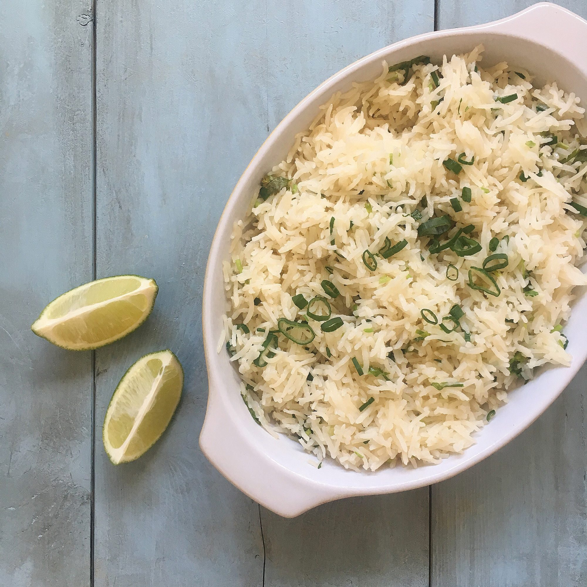 """Rice is baked in coconut water in this foolproof rice side dish. Shredded carrots, green onions, cilantro, and lime juice are added just before serving. """"I really enjoyed this!"""" says home cook LauraF. """"I thought it was tasty and very easy to prepare. I'd baked rice in the oven before — it always comes out perfectly!"""""""