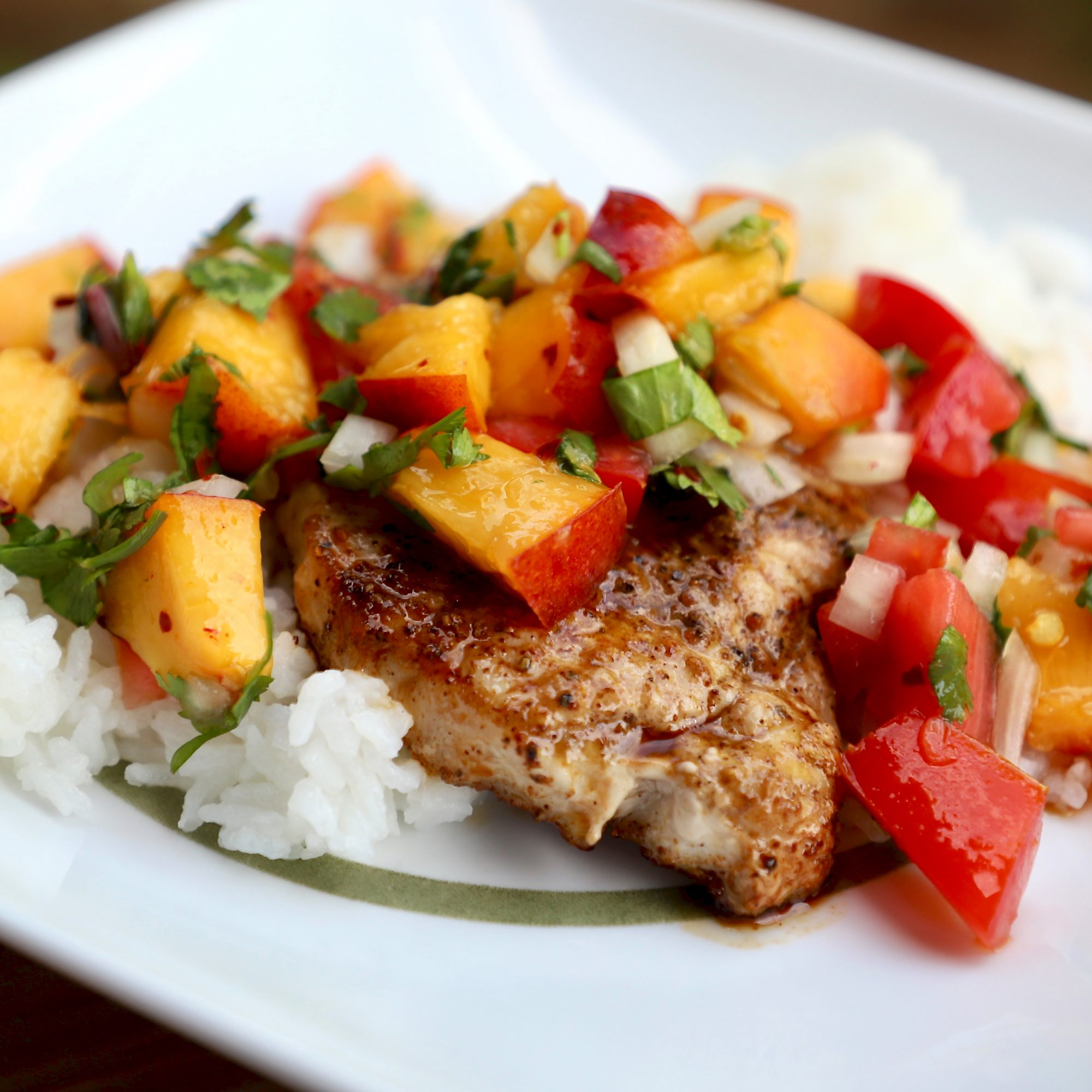 Grilled Pork Chops with Fresh Nectarine Salsa on a white plate