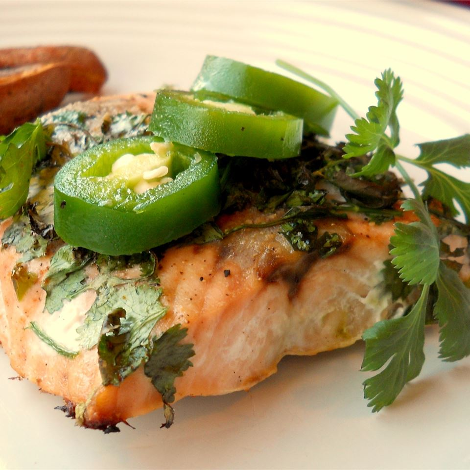 Grilled Salmon with Cilantro Sauce on a white plate