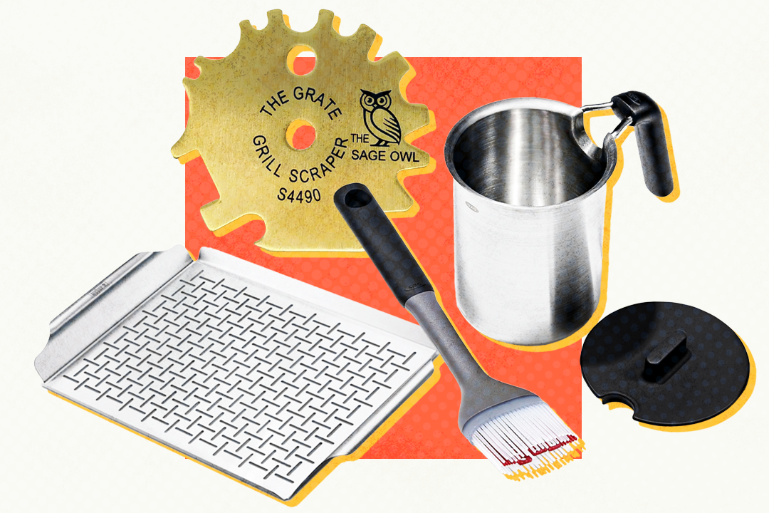 array of grilling tools including a grill pan, brass grill scraper, basting brush and basting pot