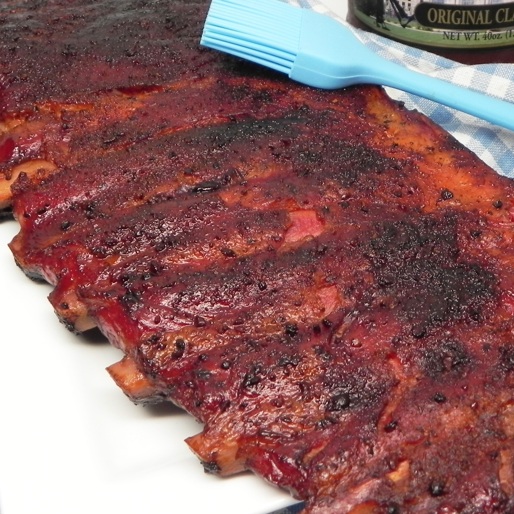 close up of rack of smoked pork spareribs with BBQ sauce