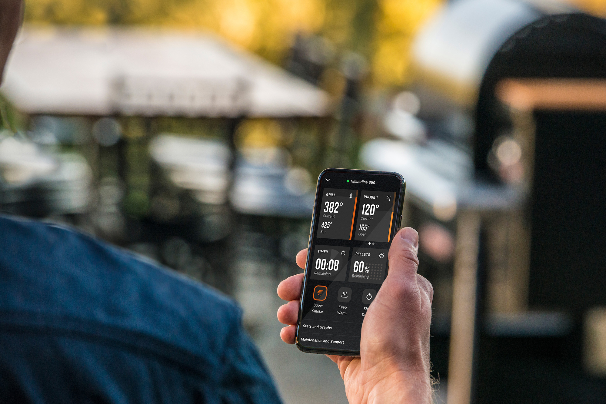 Traeger pellet grill mobile phone application screen in action