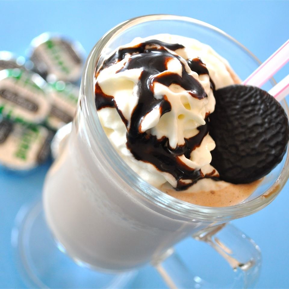 chocolate mint milkshake topped with whipped cream, chocolate syrup, and a chocolate mint cookie