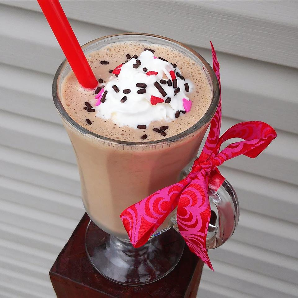 chocolate milkshake topped with whipped cream and candy sprinkles