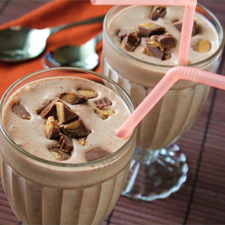 chocolate shake garnished with peanut butter cup candies
