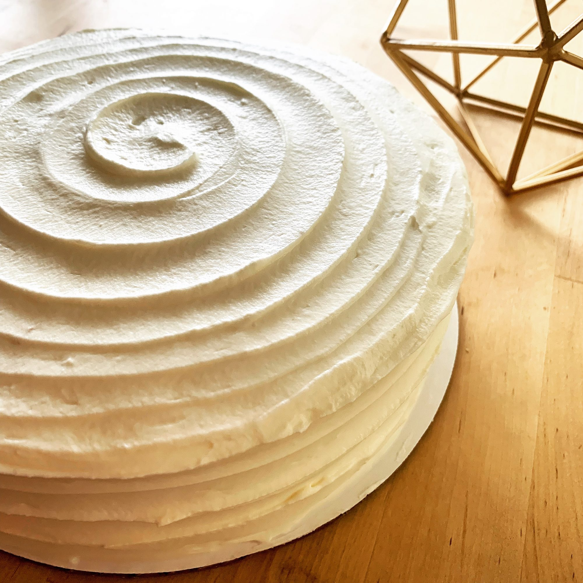 tres leche cake with swirled white frosting