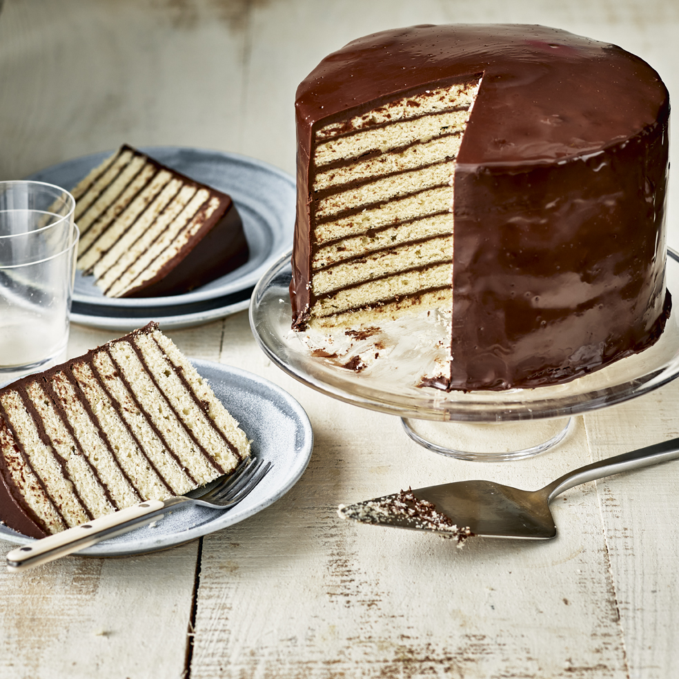 cake with many layers with chocolate filling and chocolate ganache