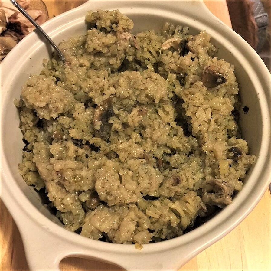 rice stuffing in a white casserole dish