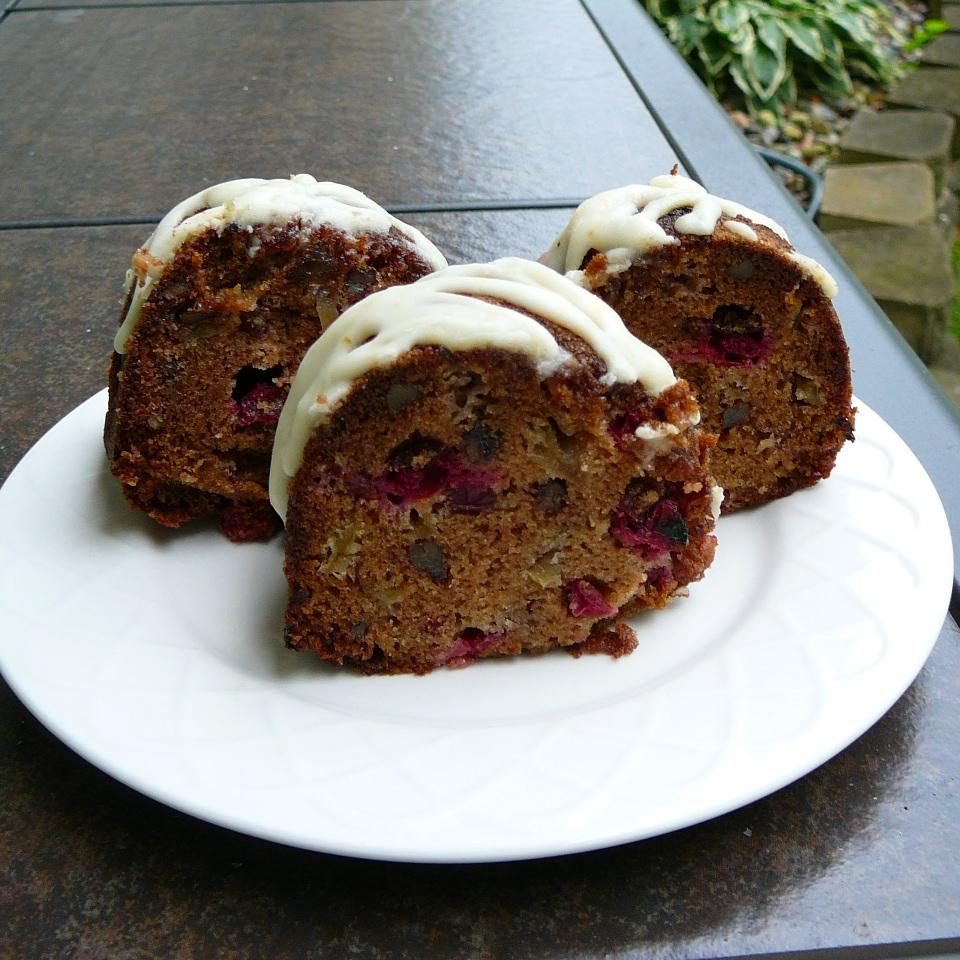 three slices of poundcake with nuts, cranberries, and icing