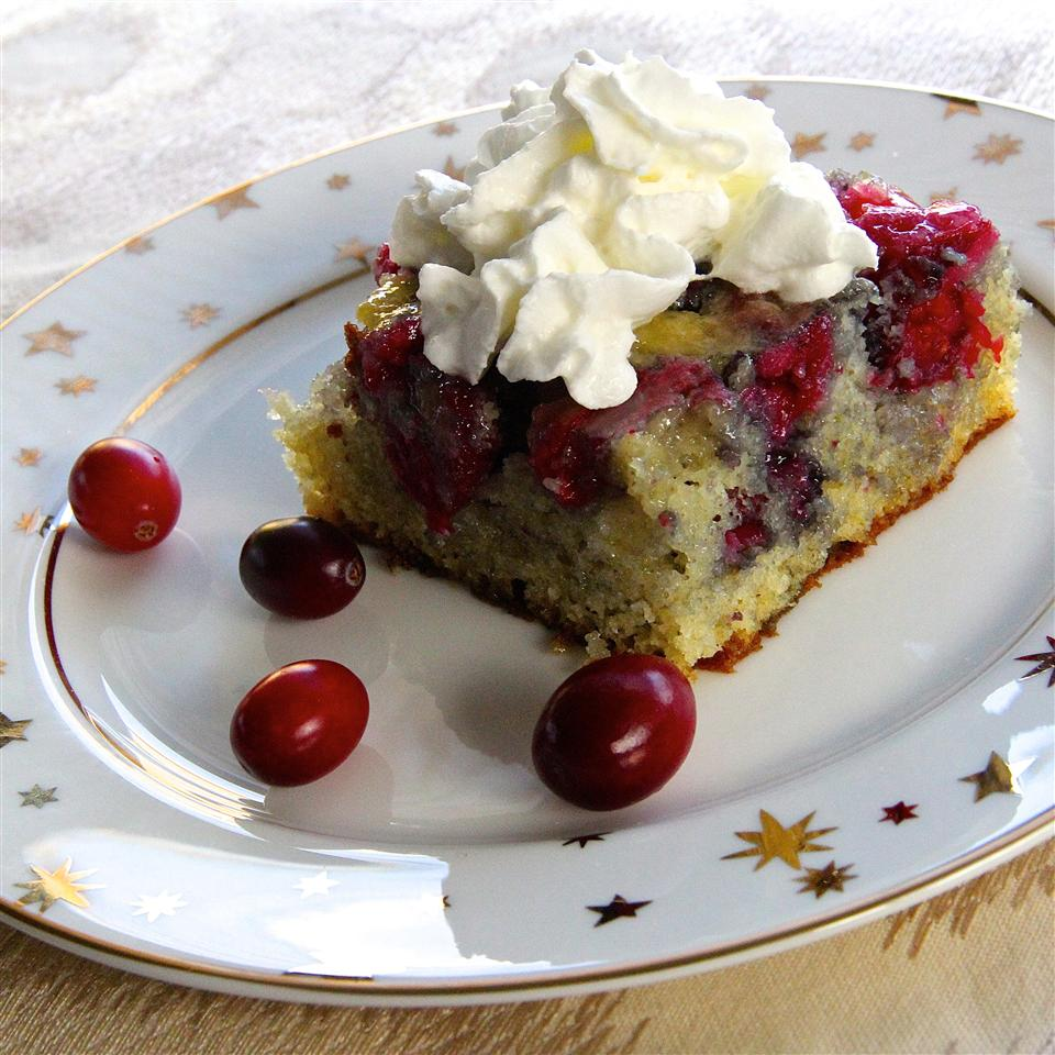 square cranberry cake with fresh cranberries and whipped cream