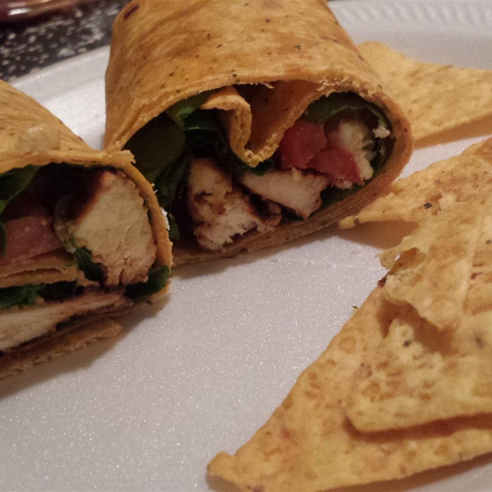 Chicken, Feta Cheese, and Sun-Dried Tomato Wraps on a white plate