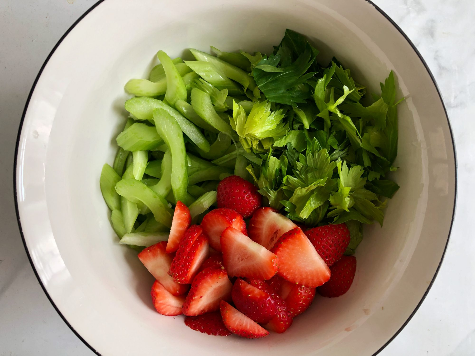 Chopped celery and sliced strawberries