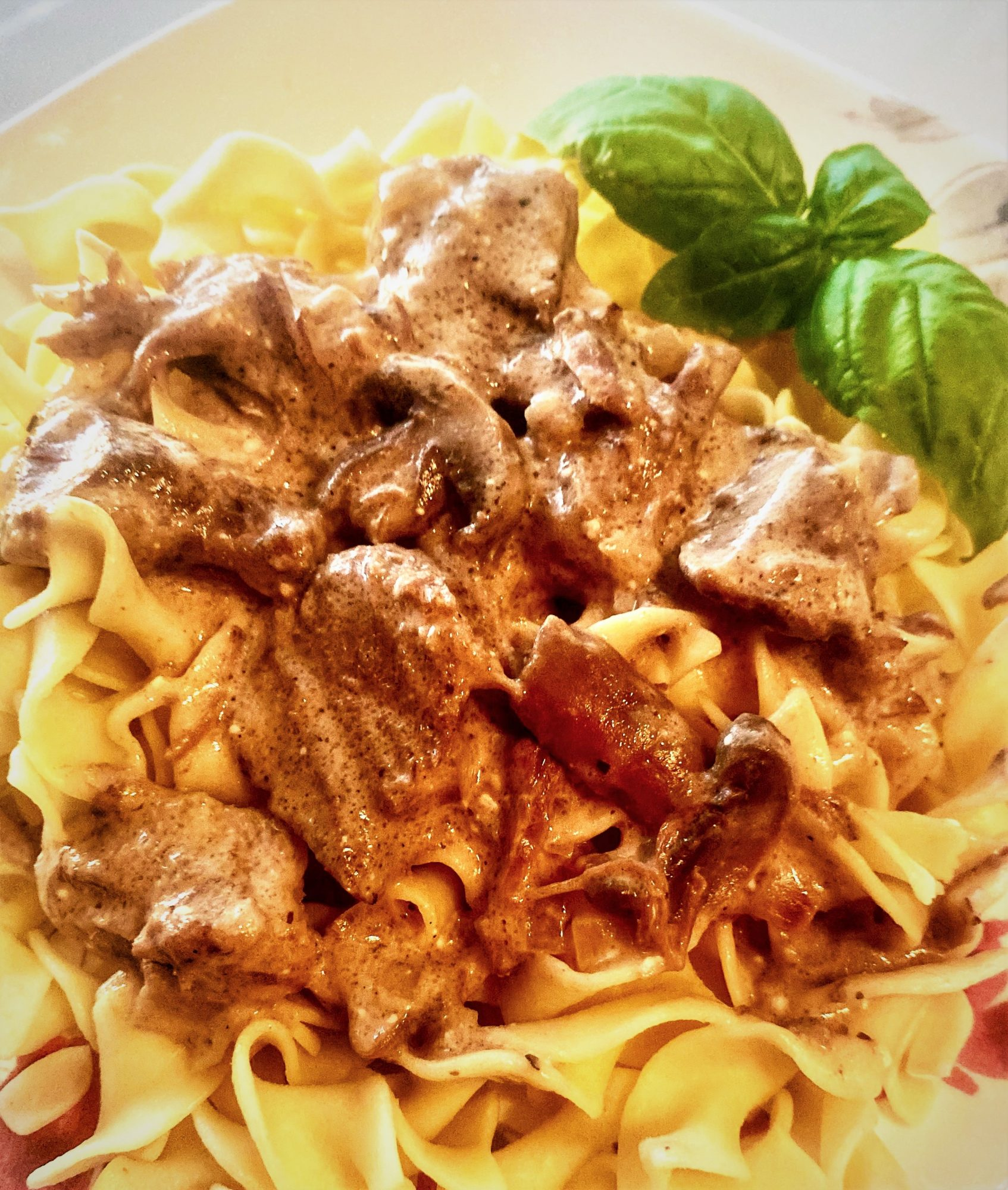 Easy Beef Stroganoff in the Slow Cooker recipe served on egg noodles