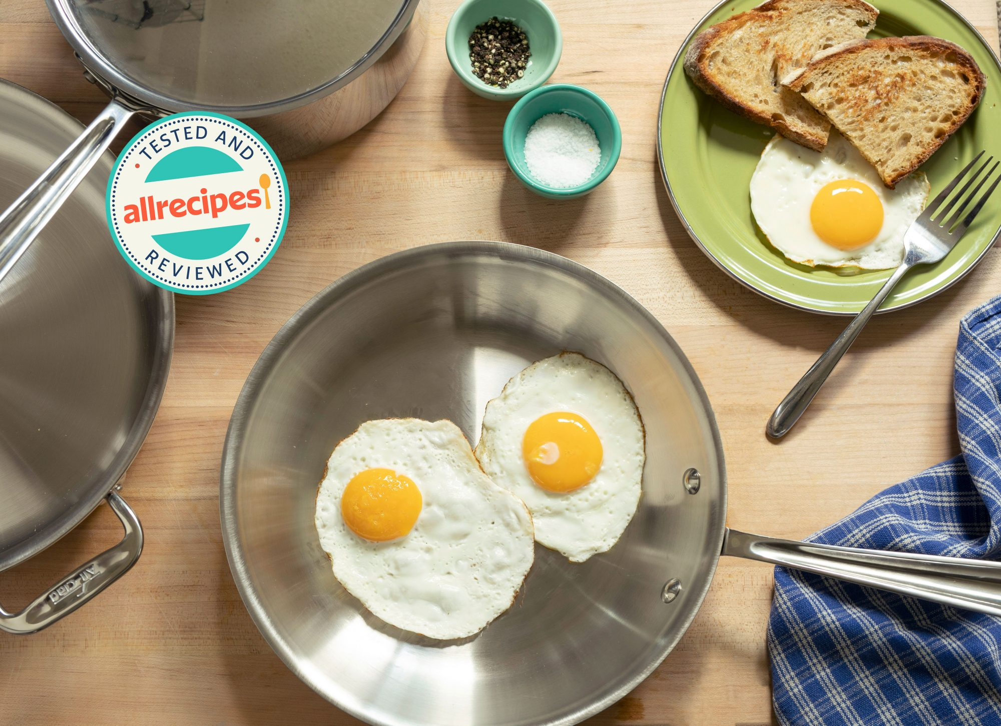 stainless steel cookware with fried eggs