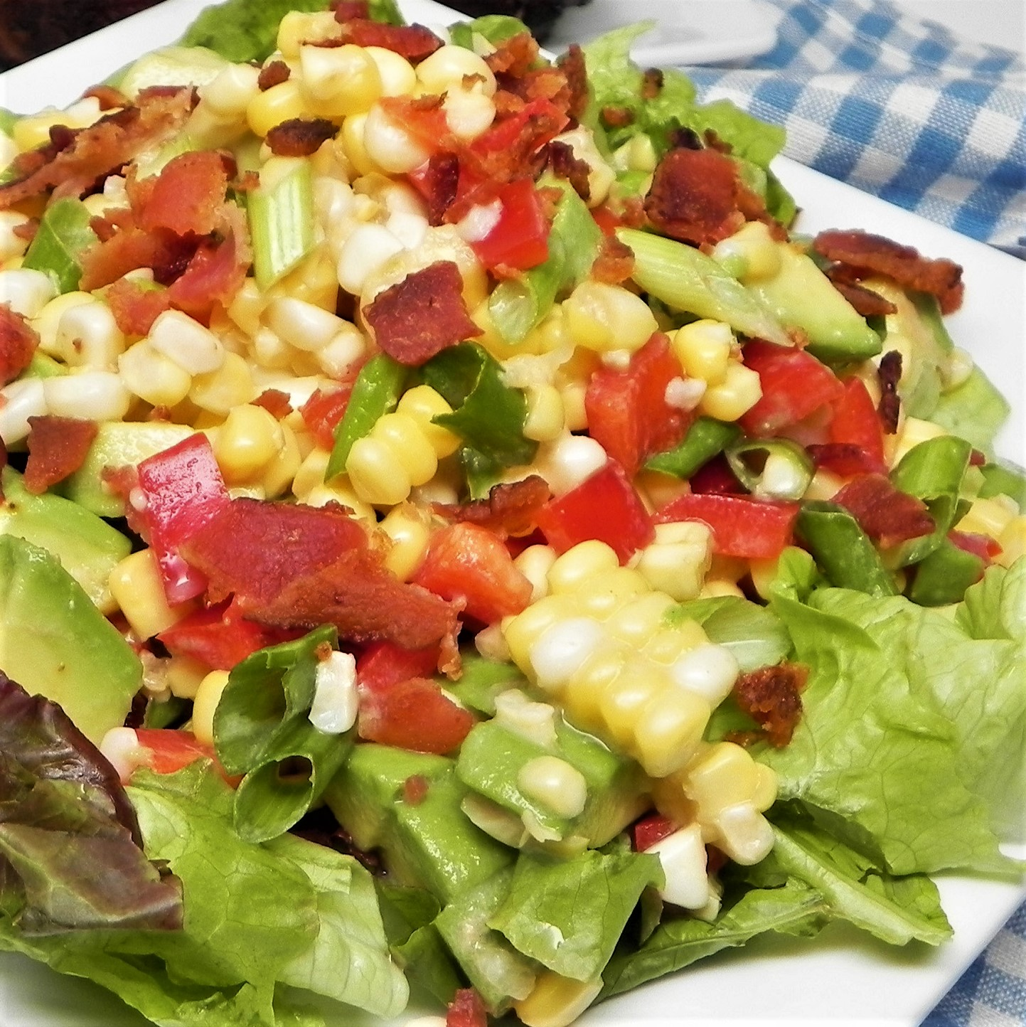 corn and avocado salad on white plate