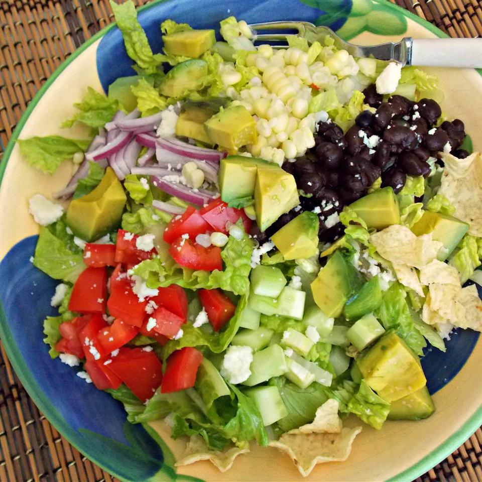 a plate full of chopped vegetables for a salad